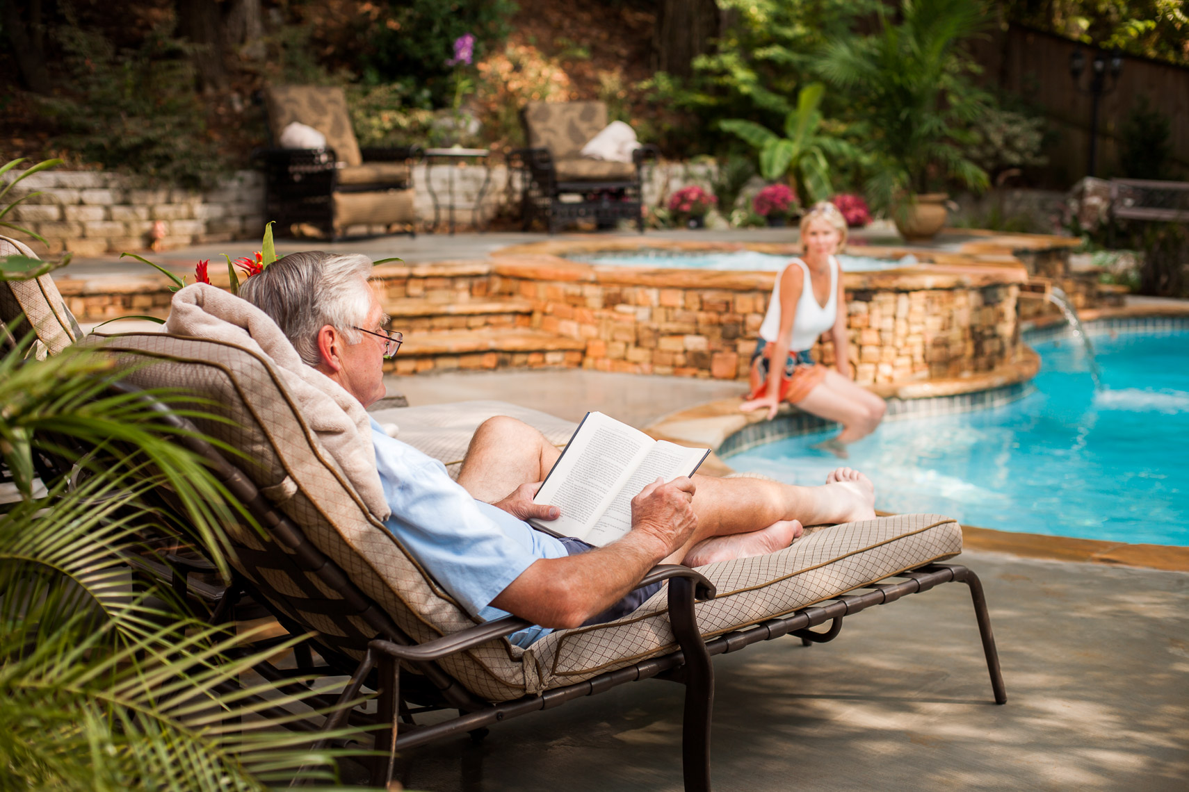 Lifestyle Photo of Older Couple at Pool